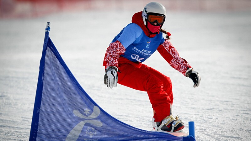 Snowboarder going down the slop in Pyeong Chang Korea.