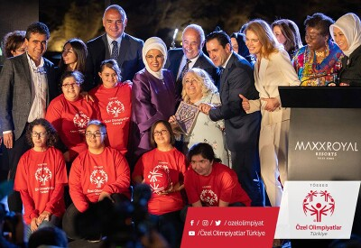"""Dilek Sabancı, Honorary Chairwoman of Special Olympics Turkey, with Special Olympics Turkey athletes at recent 2018 """"Let's Talk"""" event where she received an award honouring her inspirational efforts to combat taboos and stigmas around women's health. She is on stage with Natalia Vodianova, Europe Eurasia leadership, and Special Olympics athletes."""