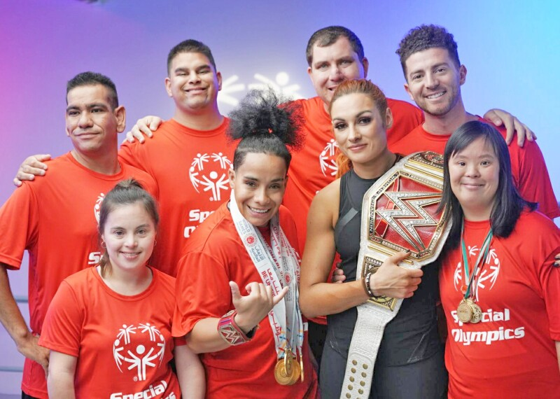School of Strength Athletes pose with WWE Superstar Becky Lynch