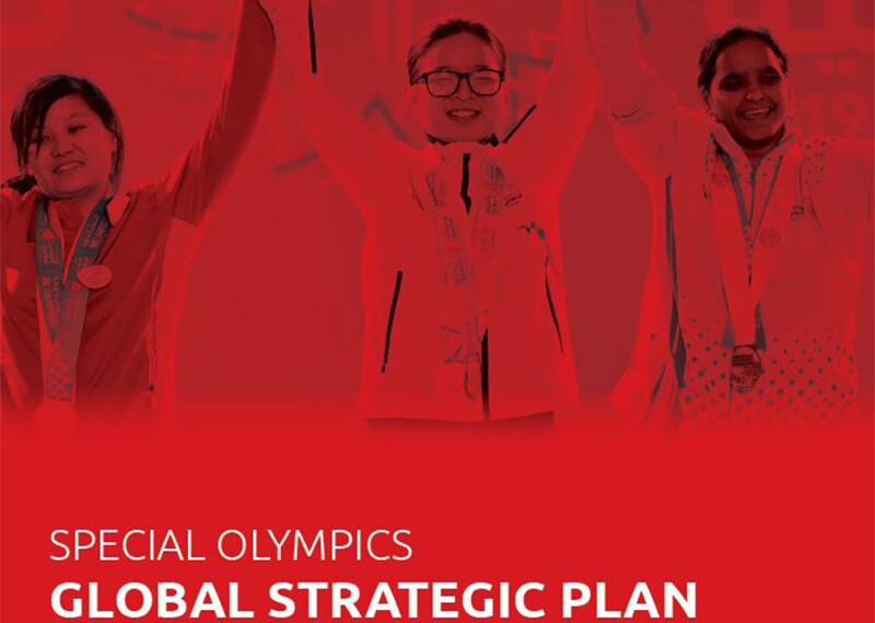 Three athletes holding hands with their hands raised up in the air. Text reads: Special Olympics Global Strategic Plan