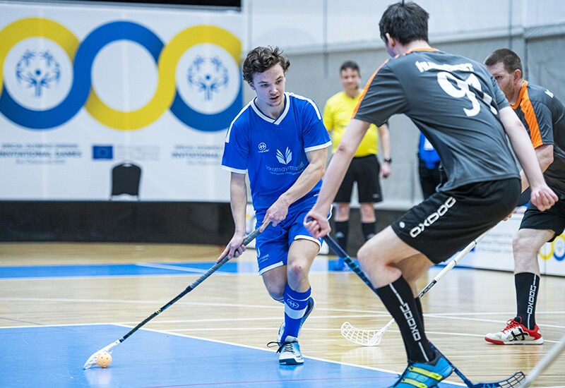 Athletes competing in floorball.