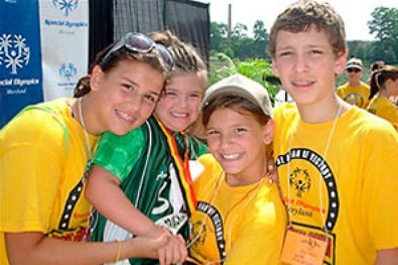 """Rosa Marcellino, 9, second from left, is shown with siblings Maddie, 13, Gigi, 11, and Nick, 15, during the Special Olympics state games, held in June. Rosa has Down syndrome and is the inspiration behind """"Rosa's Law"""" that removes the terms """"mentally retarded"""" and """"mental retardation"""" from federal education, health and labor laws."""