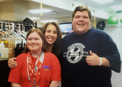 Janet Rollero with athletes