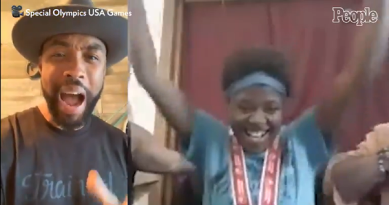A video screen shows a Special Olympics athlete celebrating as she learns she'll compete at the 2022 Special Olympics USA Games.
