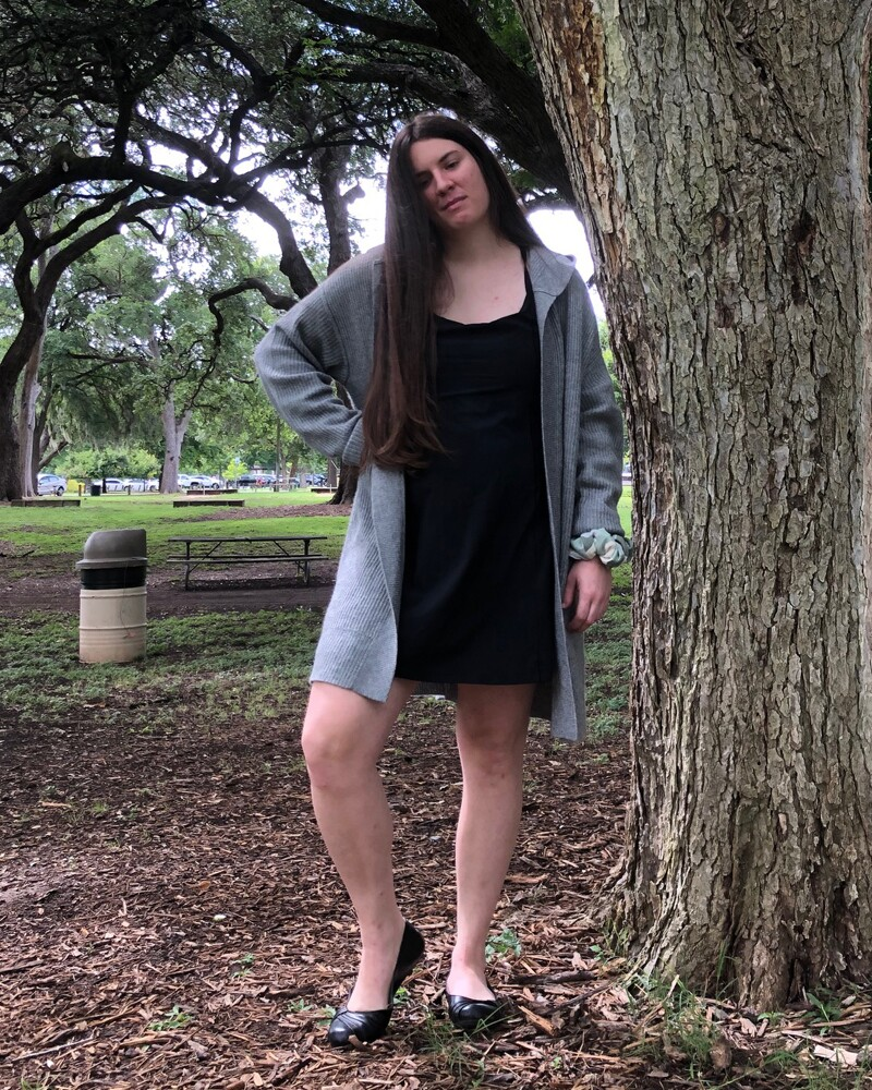 Kaylah Hankins outside standing next to a tree.