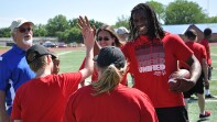 Jamaal Charles giving athletes on the field a high-5