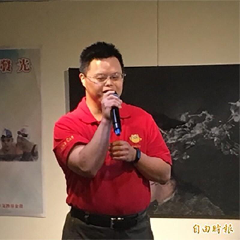 Michael Fan delivering a speech.