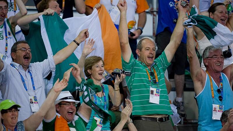 Spectators cheering in the stands.