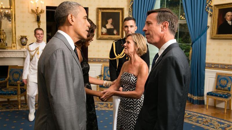 Arne Sorenson speaks to President Barack Obama at the White House.