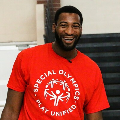 Andre Drummond in a red Special Olympics Play Unified t-shirt.