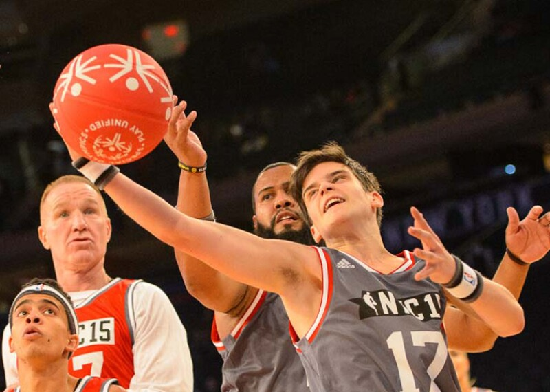Special Olympics Belgium athlete Cedriek Beerten (No. 17) reaches for the ball during the 2015 NBA Cares Unified Basketball Game at Madison Square Garden in New York City.