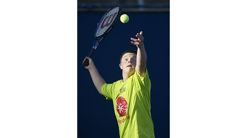A male tennis player serving the ball at Special Olympics World Summer Games Los Angeles 2015