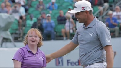 Amy Bockerstette with Gary Woodland on the golf course