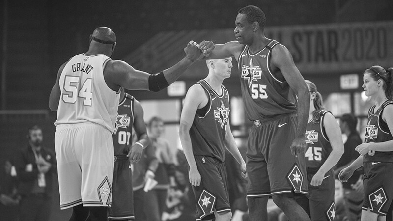 Two players from opposing teams showing each other respect on the court.