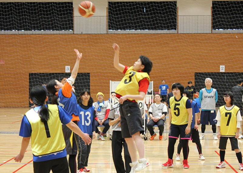 Girls playing basketball on a court.