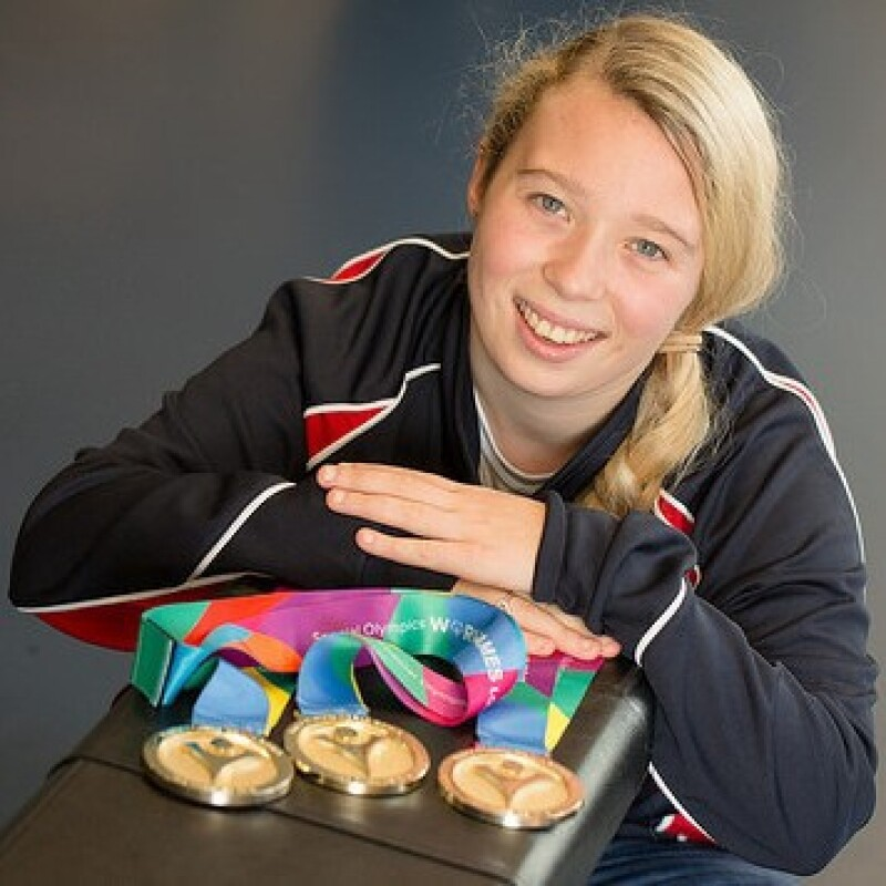 Athlete Kiera Byland with her medals won from competing in the Special Olympics World Games