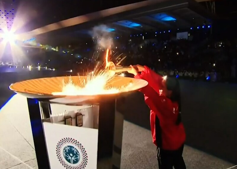 Athlete lighting the eternal flame during the opening ceremony.