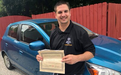 Reidl showing off his certificate of becoming a certified Special Olympics coach.