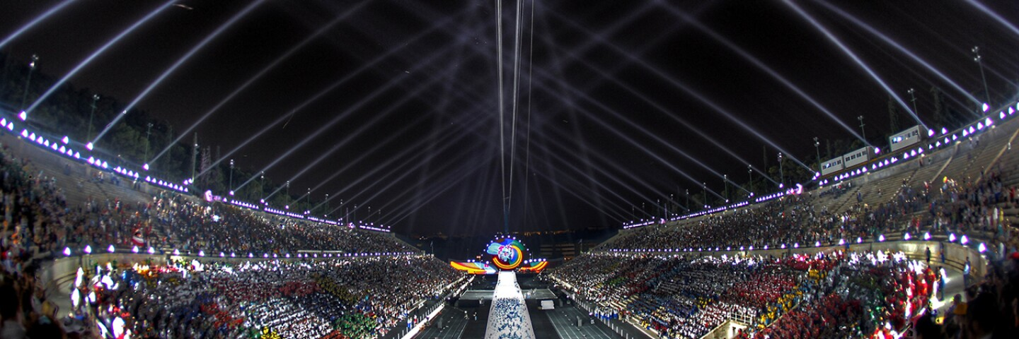 2011 World Game Opening Ceremony at night with bleachers full and a light show in the sky.