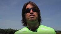 Coaching in sunglass and green shirt talking.