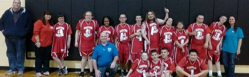 Coed Basketball team photo, with Amber at the far right.