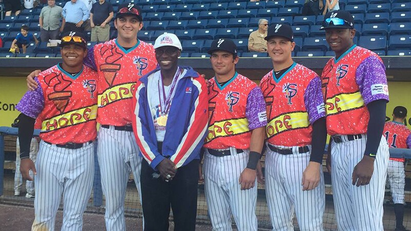Hankins (third from left) standing with members of the Staten Island Yankees, who wore jerseys designed by Hankins for Special Olympics New York night in 2016.