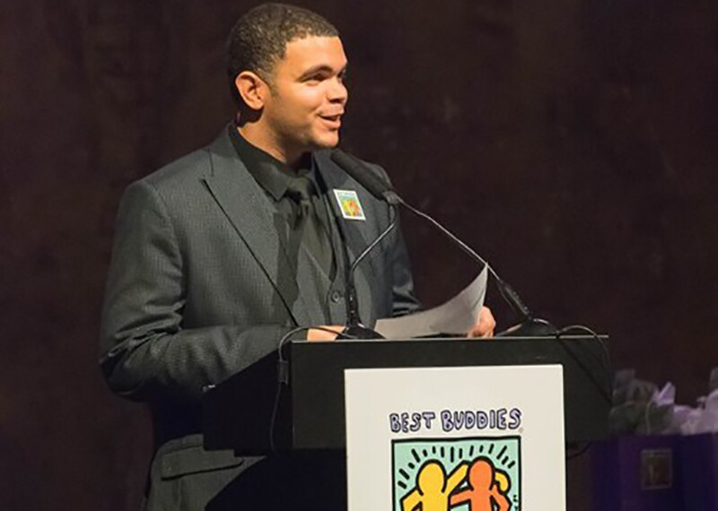 Paul Brooks speaking standing behind a podium at the Minnesota Champion of the Year Gala in November 2018