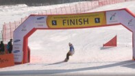 snowboarder coming to the finish of the race.