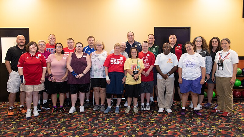Cindy Schopper stands with the Special Olympics Bowling Team.