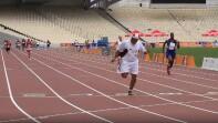 Athletes running on a track.