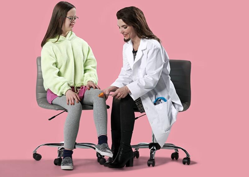 Doctor testing patients reflexes.