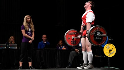 Athlete Mitchell Betsworth deadlifts on stage at the 2018 USA Games.
