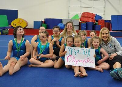 Coach Elaine and Rachel with gymnastics athletes.