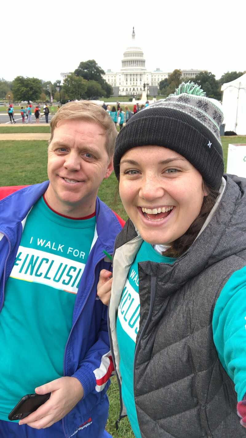 "Megan Jean and Robby ""Bobby"" Jones at the Best Buddies Walk on the National Mall in front of the United States Capitol. Both Megan and Bobby have on turquoise Best Buddies t-shirts that say ""I Walk for Inclusion""."