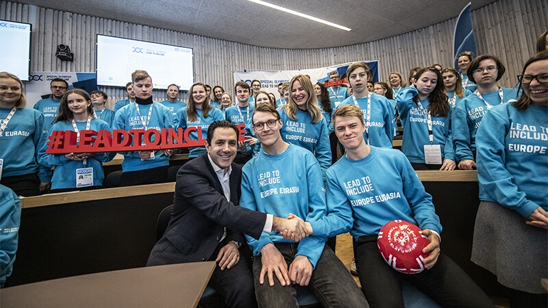 A group of young adults standing together in a large group at Special Olympics Youth Summit in Östersund 2020