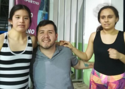 Ruben with two young women.