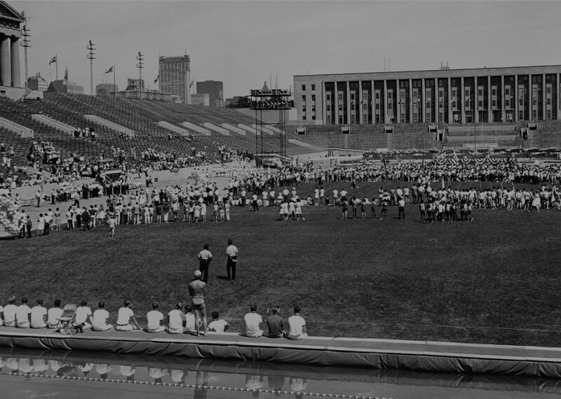 1962 image of Soldier Field with athletes on the field