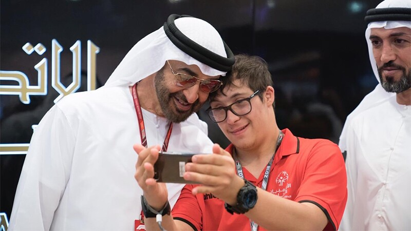 An athlete taking a selfie with a man.