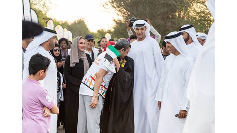 H.H. Sheikh Abdullah greets other members of the Ministry of Tolerance before the walk begins. Spectators and media look on as the leaders great one another.