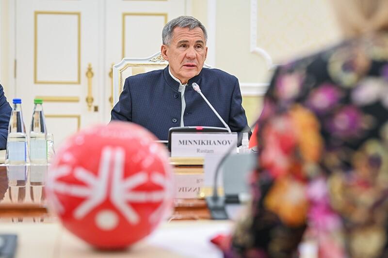 President of the Tatarstan region, Rustam Minnikhanov sitting and speaking.