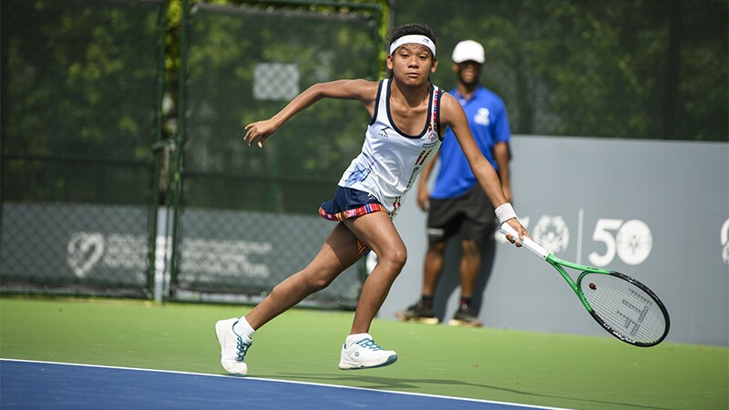 Female athlete tennis player on the court running for the ball.