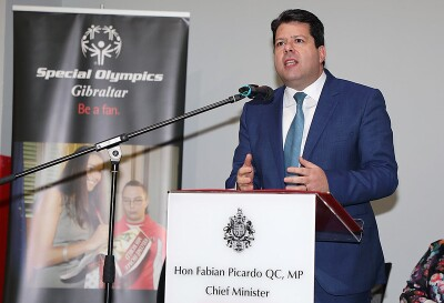 Honorable Fabian Picardo standing behind a podium and speaking