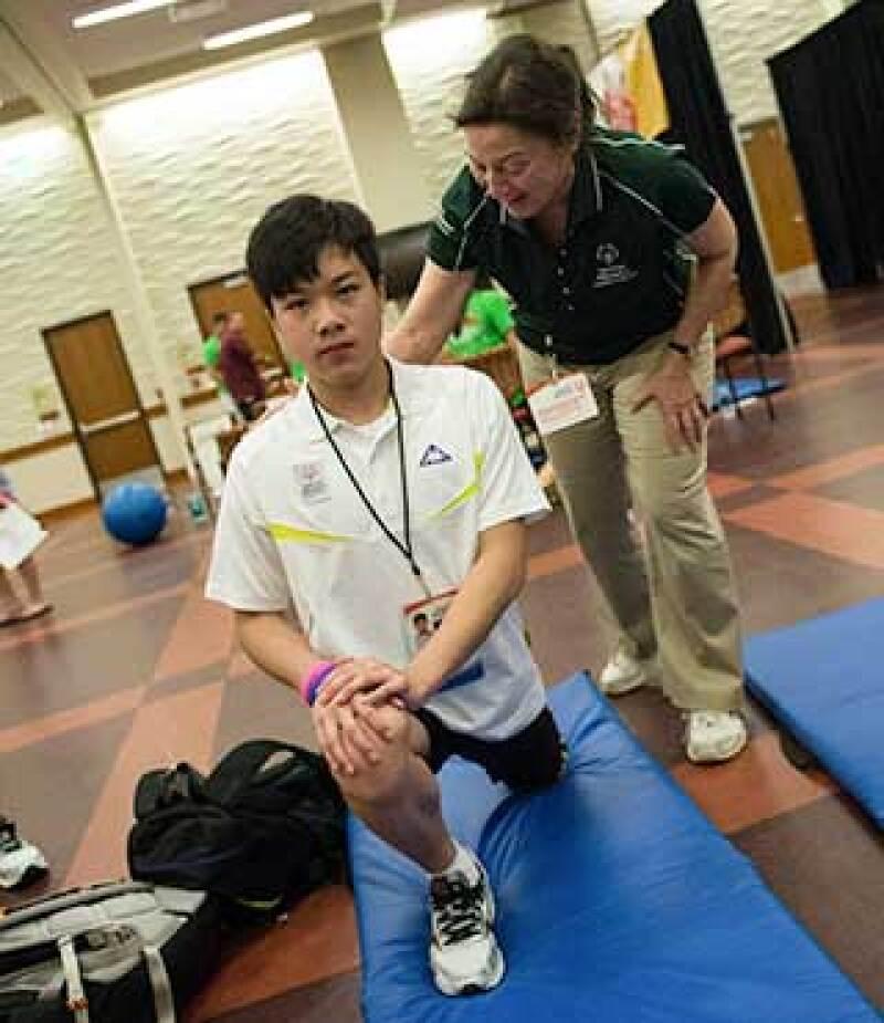 Special Olympics Hong Kong swimmer Ka Hun Chui has his flexibility measured at a health screening clinic.