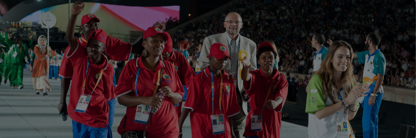 Eswatini delegation and representatives walking on stage during a games opening.