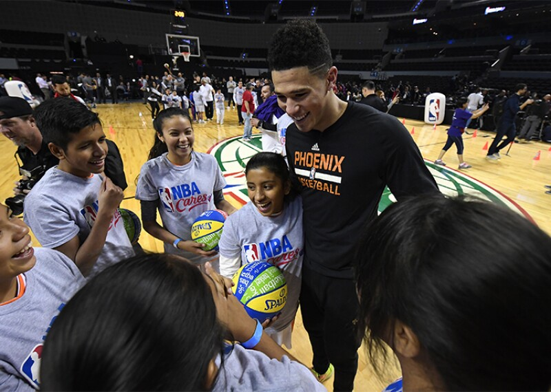 Devin Booker with athletes.