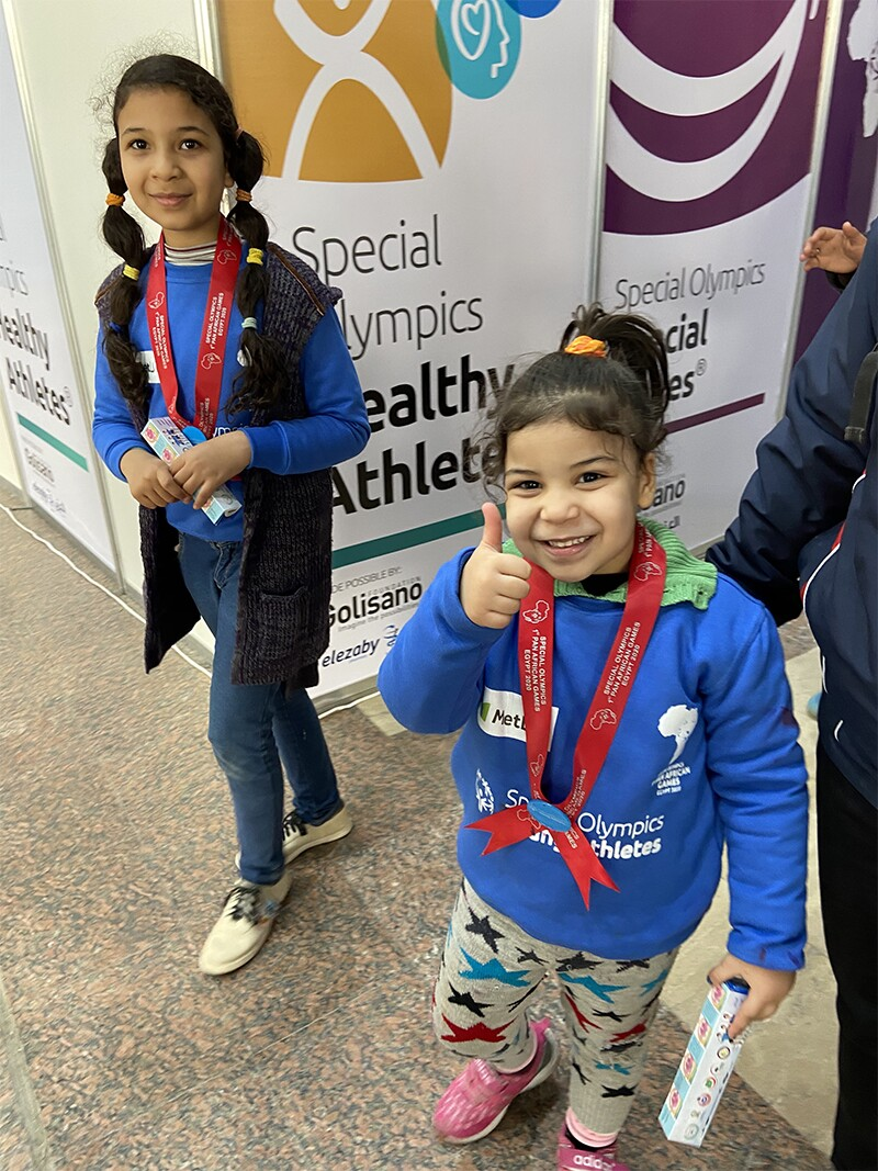 A young athlete gives a thumbs up after a screening.