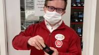Steven at work wearing his red Target zip up.