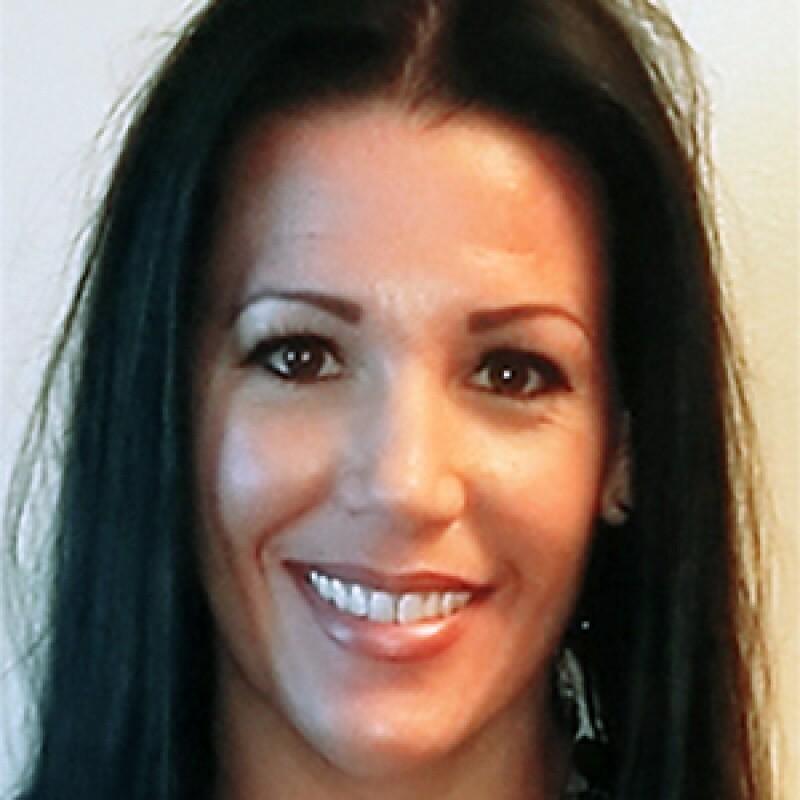Olivia Contreras smiling in a portrait photo