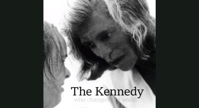 Eunice Kennedy Shriver looking at a young athlete.