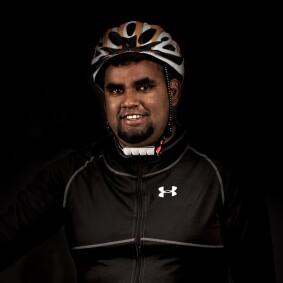 Al-Sayyed Curumthaullee in a bike helmet.